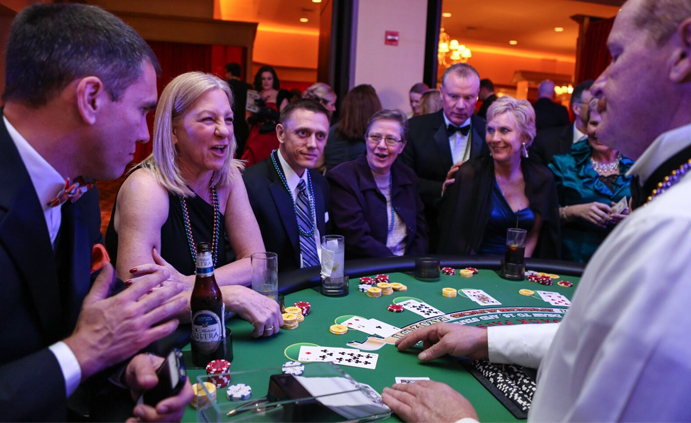 In our website redesign for Contemporary Productions, we placed a focus on imagery that shows the thrill of the experience. Here, event attendees play an exciting round of black jack.