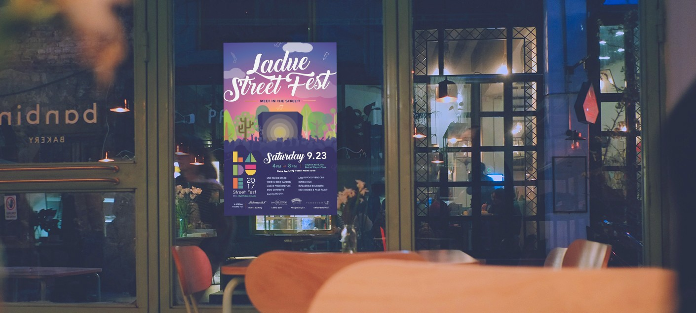 The final designed and printed poster for the Ladue Street Fest, hanging inside a local business to promote the event.