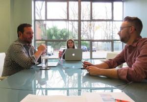 The Paradigm team during a strategic brainstorm for a digital marketing campaign.