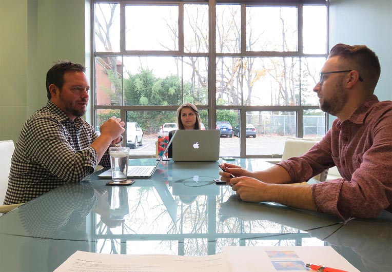 The Paradigm team during a strategic brainstorm for a digital marketing campaign.