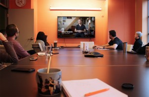 The Paradigm team during our weekly Share meeting, sharing a video on advancements in robotics.