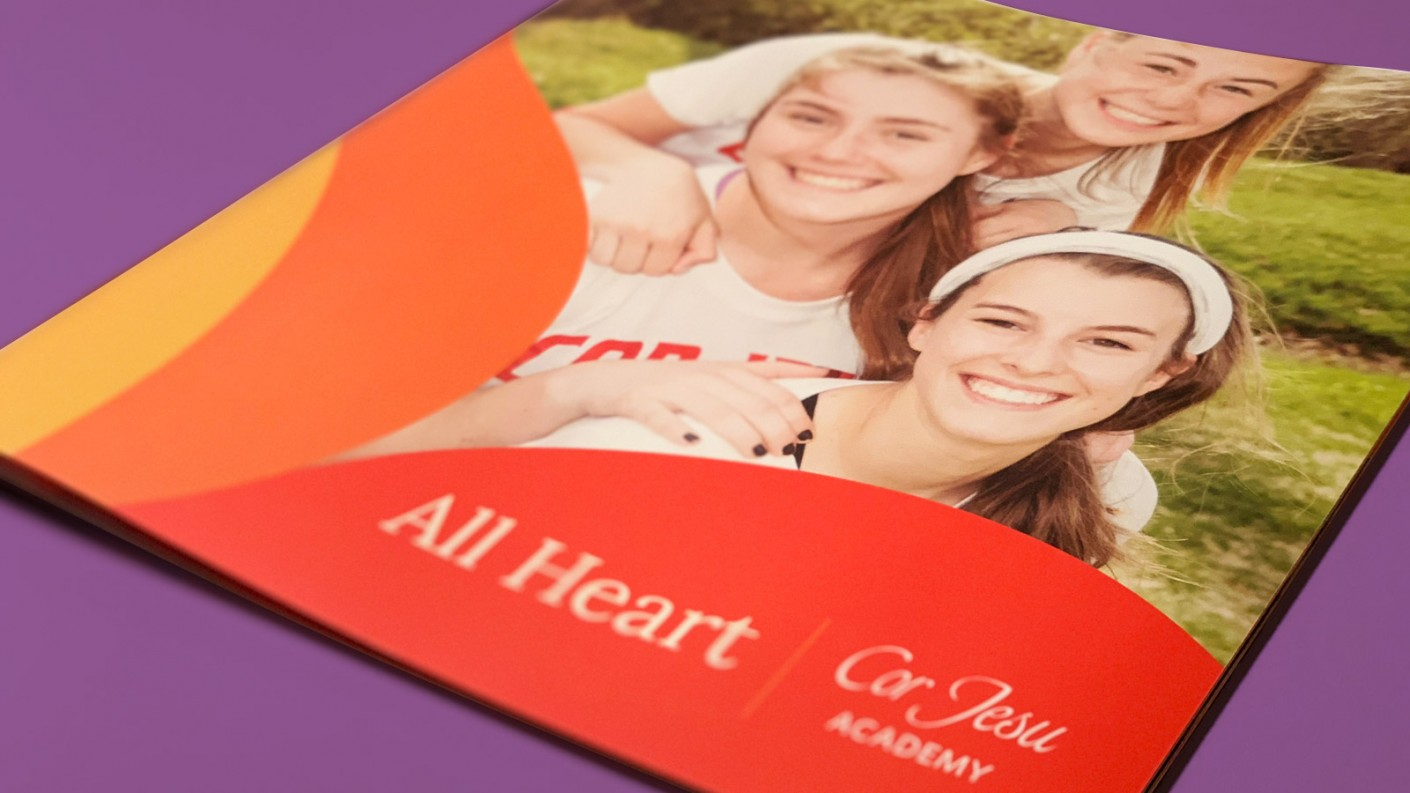 The cover of the Cor Jesu Academy viewbook proudly shows the new All Heart branding.