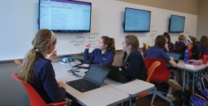 Students working in class at Cor Jesu Academy. Classrooms feature the latest technology for improved collaboration and accelerated learning.
